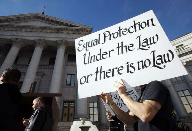 DENVERA participant holds a sign up during a protest against California's Proposition 8 outside the City/County Building in Denver on Saturday. Nearly 1,000 people were there to voice their opposition to Proposition 8. Photo: David Zalubowski, AP