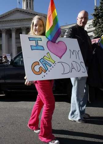 DENVERTen-year-old Emma Weldert-Roth, of Highlands Ranch, Colo., holds up a sign in support of her gay fathers during a protest against the passage of California's Proposition 8 Saturday. Photo: David Zalubowski, AP