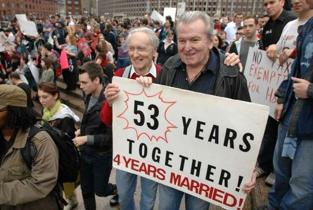 BOSTONRalph Hodgdon, 74, left, and Paul McMahon, 75, both of Boston, protest against the passage of California's Proposition 8 at City Hall Plaza in Boston Saturday. They were married in Boston in 2004 and were among several thousand demonstrators protesting Proposition 8. Photo: JOSH REYNOLDS, AP