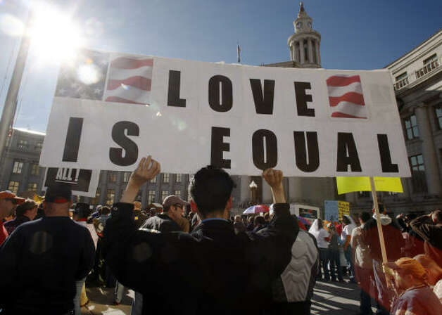 DENVERLuke Duran holds up a sign during a protest against the passage of Proposition 8 outside the City/County Building in Denver on Saturday. Photo: David Zalubowski, AP