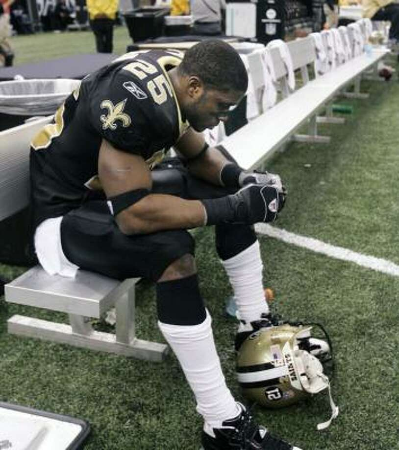 Reggie Bush had a rough second season, but quarterback Drew Brees remains a believer. Photo: Judi Bottoni, AP