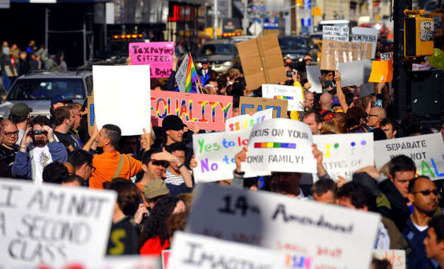 NEW YORK CITYProtestors gather near City Hall to rally against Proposition 8, Saturday. Photo: Stephen Chernin, AP