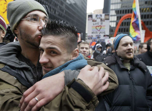CHICAGOJoseph Mercado and Justin Niehoff embrace as they protest a gay marriage ban approved two weeks ago by Californians in Chicago's Federal Plaza Saturday. Photo: M. Spencer Green, AP