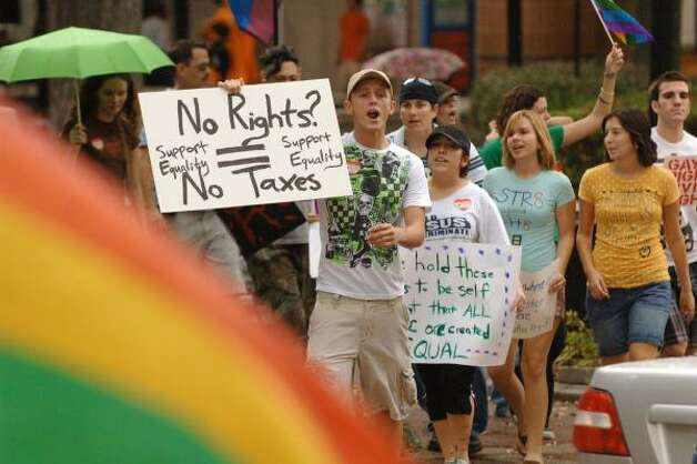 JACKSONVILLEProtesters parade through Hemming Plaza in downtown to show their disapproval of the passage of Florida Amendment 2 on Saturday. Photo: Bob Self, AP
