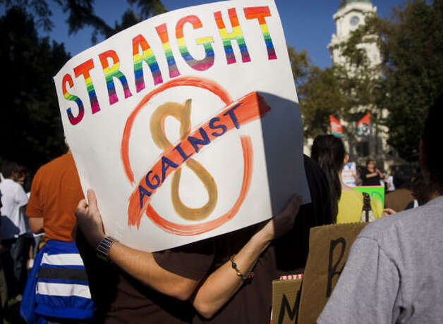 SACRAMENTORachel Begers, left, and boyfriend, Adam Clark show their support during a gay rights rally on Saturday. Photo: Autumn Cruz, MCT