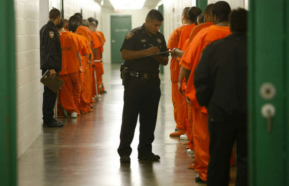 Inmates go to their cells at the Harris County Jail. If inmates tell jailers they're in the U.S. illegally, their information is entered into a database shared with ICE agents in Houston. Photo: Mayra Beltran, Chronicle