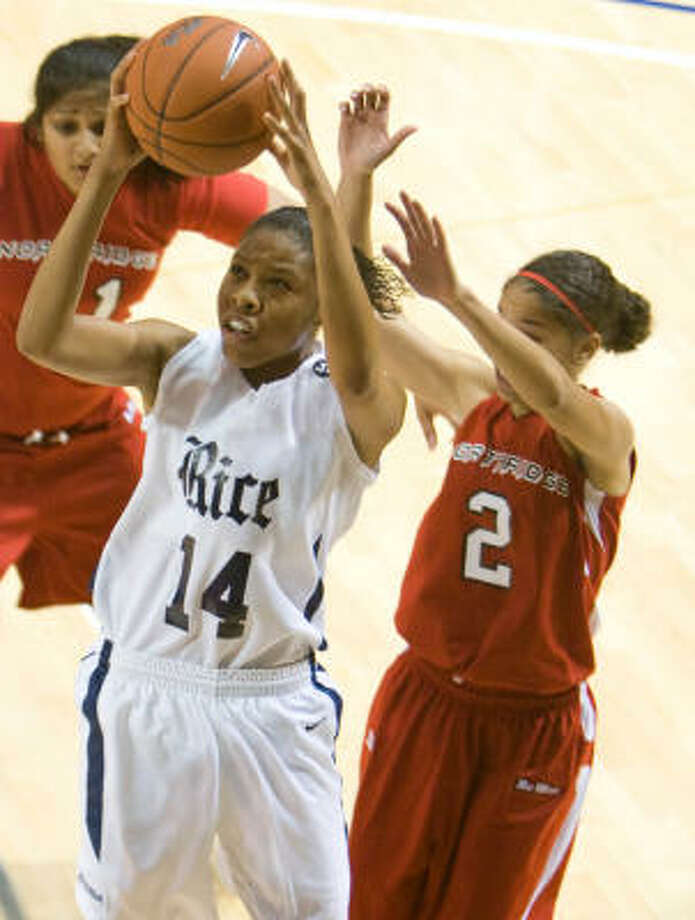 Rice's Brianna Hypolite (14) gets by Cal State Northridge's Whitney Ligon (2) for a jumper in the second half of Friday night's game at Tudor Fieldhouse. Rice won 76-55. Photo: Nick De La Torre, CHRONICLE