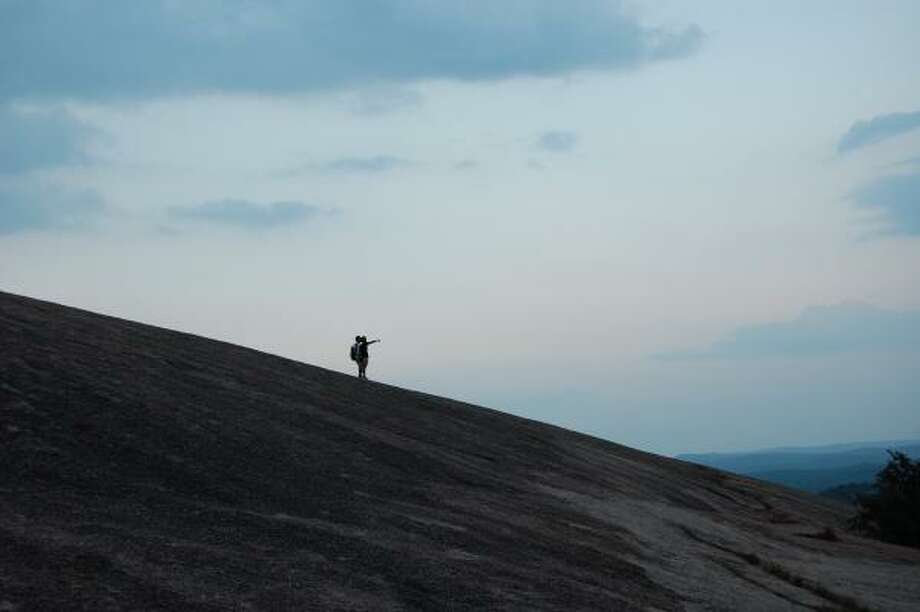 Hikers watch the sunset of Enchanted Rock. Photo: MELISSA WARD AGUILAR:, CHRONICLE