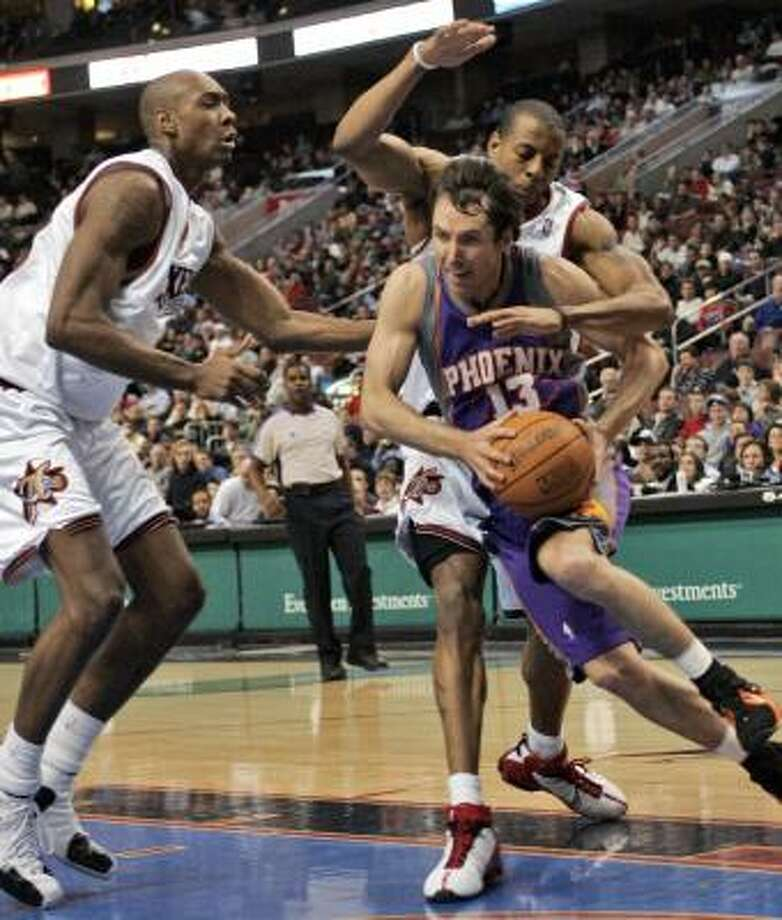 The 76ers' Steven Hunter, left, and Andre Iguodala give the Suns' Steve Nash little room to operate. Photo: GEORGE WIDMAN, ASSOCIATED PRESS