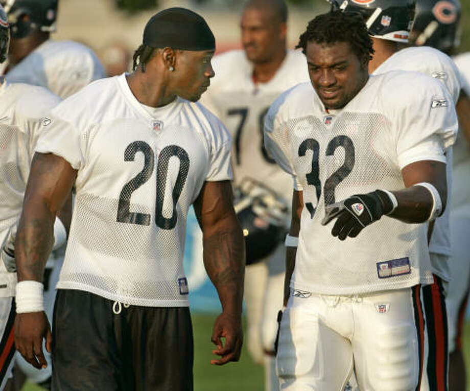 Thomas Jones, left, appears to be heading to the Big Apple, mean former Texas Longhorn running abck Cedric Benson should be the Bears feature back. Photo: JEFF ROBERSON, AP