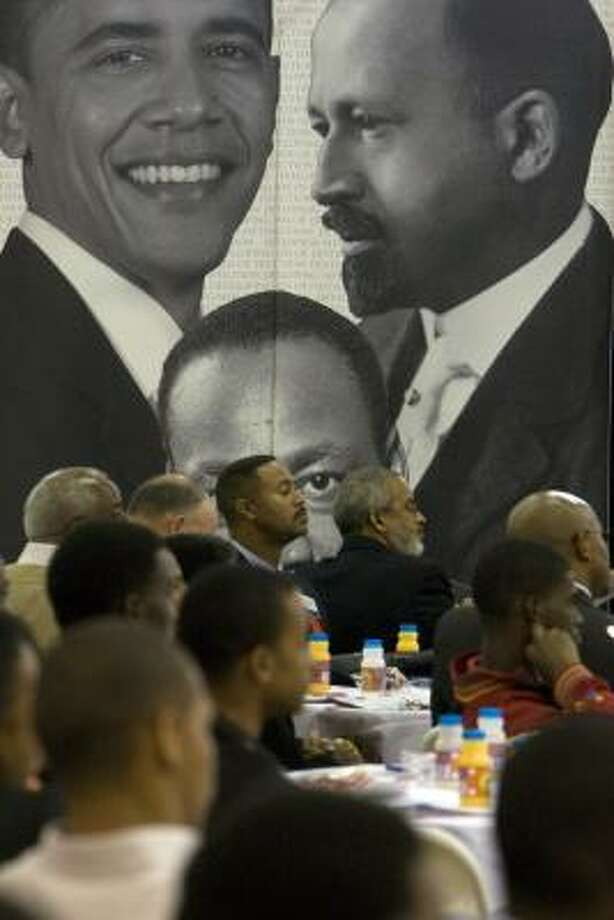 Images of Barack Obama, Dr. Martin Luther King Jr. and W.E.B. Du Bois are a backdrop for the Black Male Summit: Developing Men of Distinction. Photo: JOHNNY HANSON, CHRONICLE