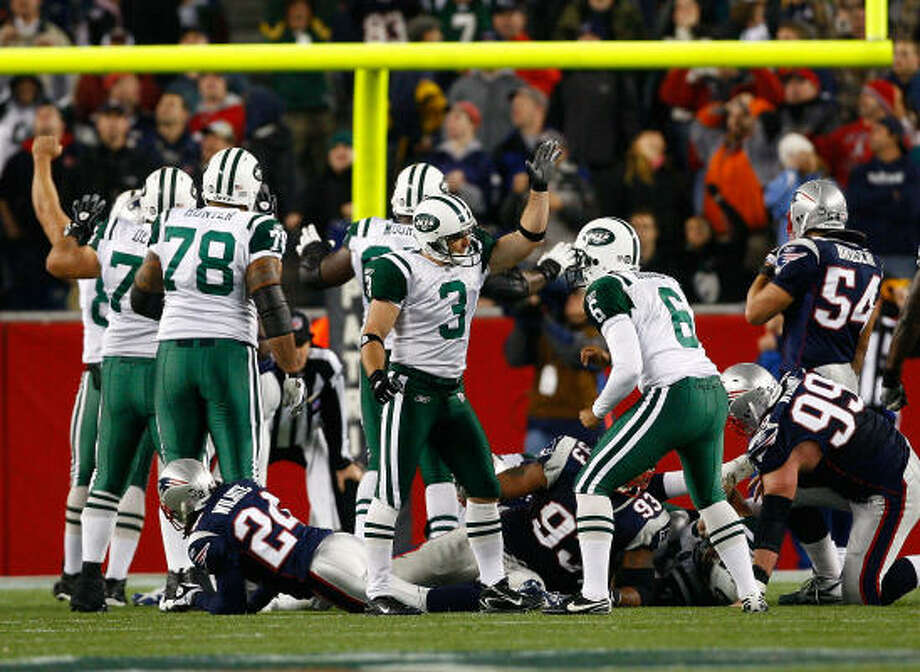 New York Jets kicker Jay Feely (3) celebrates after kicking the game-winning field goal in Thursday's 34-31 overtime win over the New England Patriots at Gillette Stadium in Foxboro, Mass. Photo: Jim Rogash, Getty Images