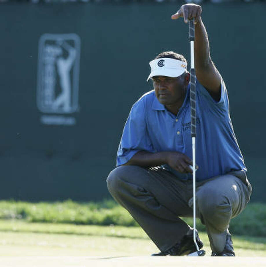 Vijay Singh lines up a putt at No. 17. His 31 tour victories tie him with Harry Cooper for the most for a player not born in the United States. Photo: David Cannon, Getty Images