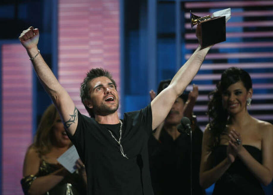 Juanes celebrates his fifth Grammy award. Photo: Mayra Beltran, Chronicle