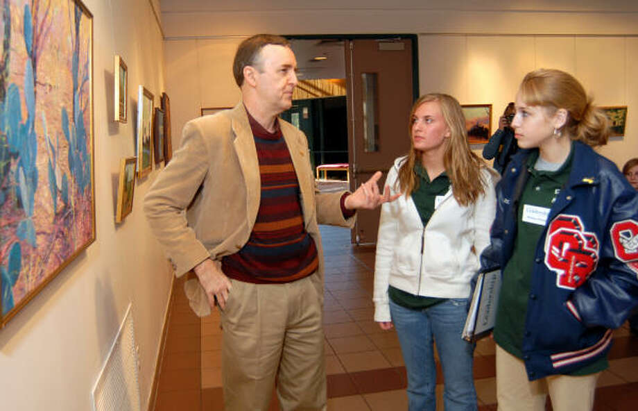 Houston artist Donald Fox talks about his painting techniques to Oak Ridge High School students Alex Vivlamore, left, and Brittany Wyman during the Leadership High School Montgomery County members attended an arts and culture session at Montgomery College. The juniors are learning how to be leaders in their community. Photo: David Hopper, For The Chronicle