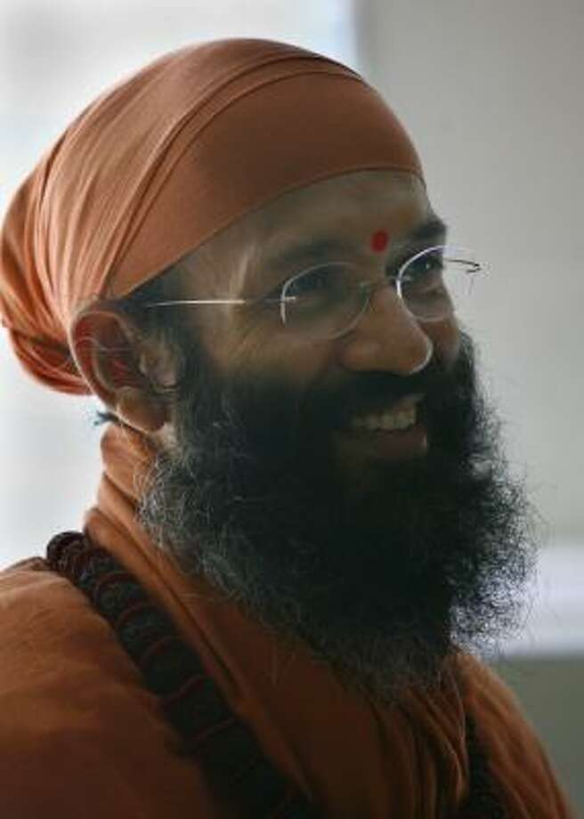 Swami Vidyadhishananda Giri conducts a series of lectures in Houston through May 23. Photo: Steve Ueckert, Chronicle