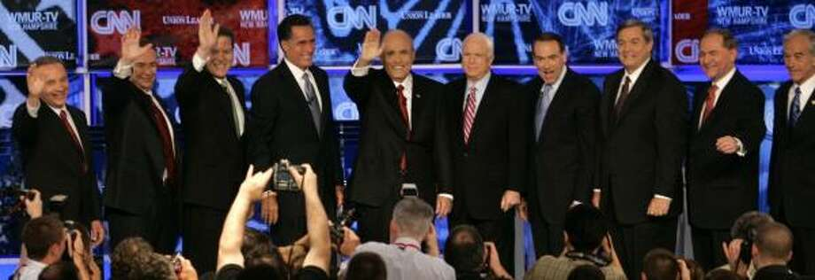 Joining in Tuesday night's GOP debate in New Hampshire were, from left, Tom Tancredo, Tommy Thompson, Sam Brownback, Mitt Romney, Rudolph Giuliani, John McCain, Mike Huckabee, Duncan Hunter, Jim Gilmore and Ron Paul. Photo: ELISE AMENDOLA, Ap