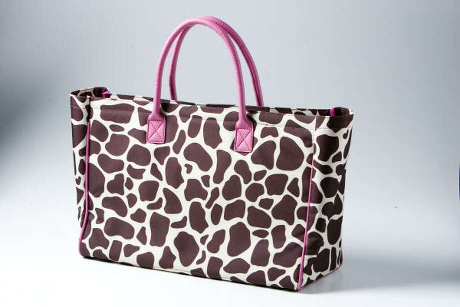 A leopard tote with pink handles ($56) from A Bientot. Photo: Brett Coomer, Chronicle