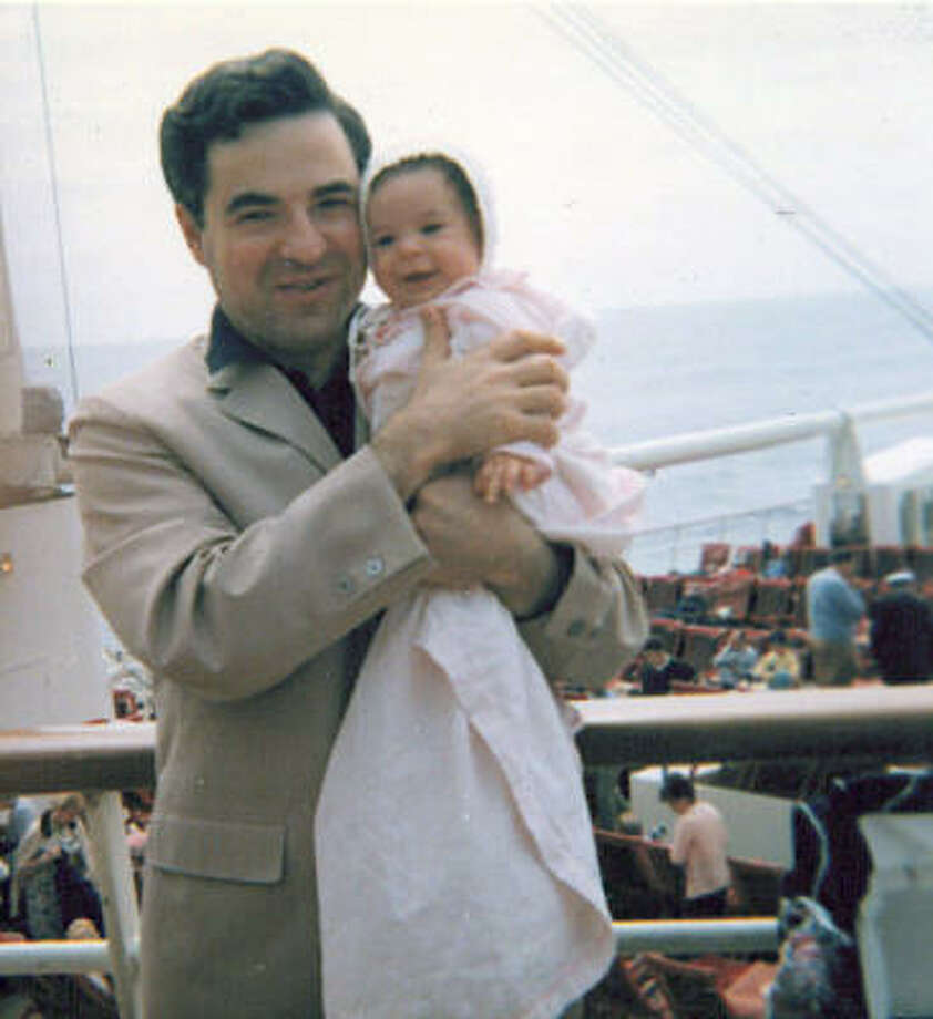 Arthur Frommer holds his daughter Pauline on a trans-Atlantic crossing from New York to France in 1965 on the S.S. France. Photo: Associated Press/Arthur Frommer