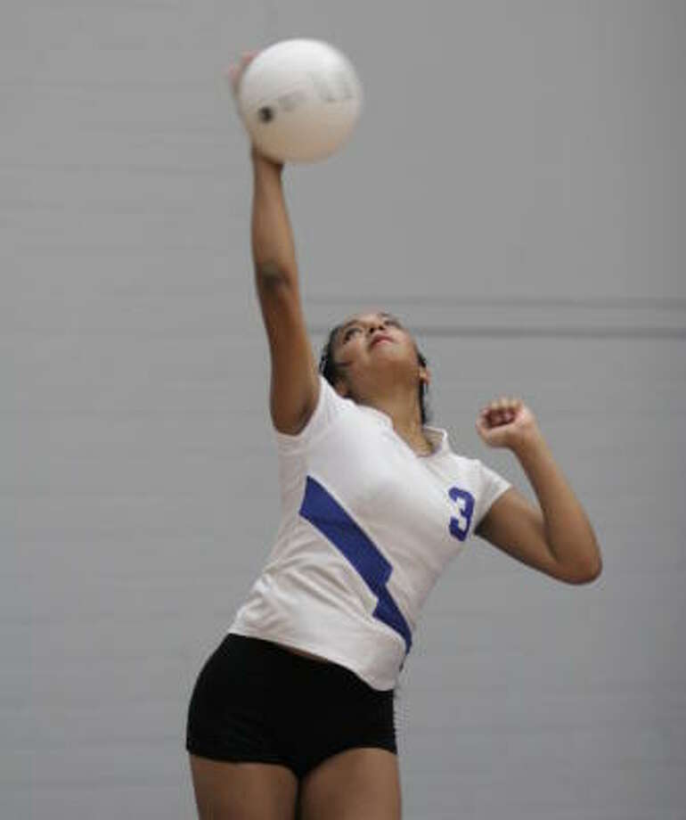 Chavez' Karla Raygoza delivers a serve in a match against Lamar last week. The Lobos will face Milby at 6:30 p.m. Friday at Barnett. Photo: Kenzie DelaTorre, For The Chronicle