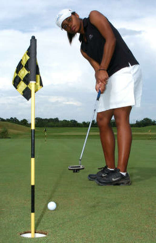 Clear Lake High School junior Gabrielle McNary gets in some practice before she travels to Pebble Beach, Calif. Gabrielle is the only Houston-area high school golfer selected to play alongside a pro at the Wal-Mart First Tee Open. Photo: Kirk Sides