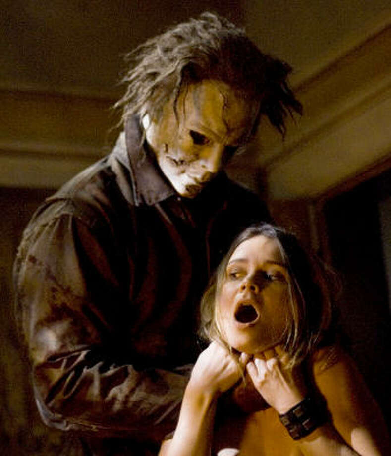 Michael Myers (Tyler Mayne) has his victim (Kristina Klebe) in his clutches in Rob Zombie's Halloween. Photo: MGM/DIMENSION FILMS