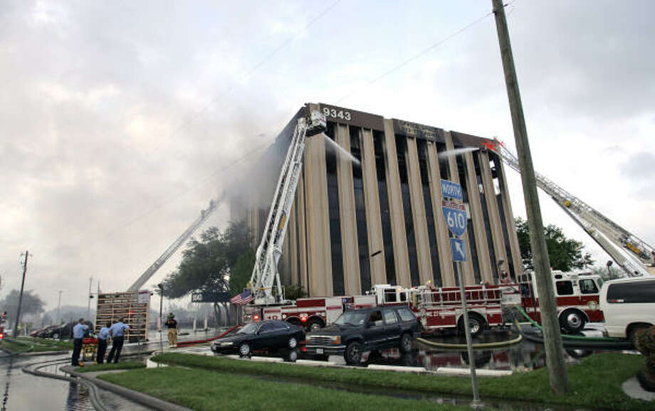 Houston firefighters battle the deadly March 28 blaze at a six-story office building at 9343 North Loop East. Photo: David J. Phillip, AP