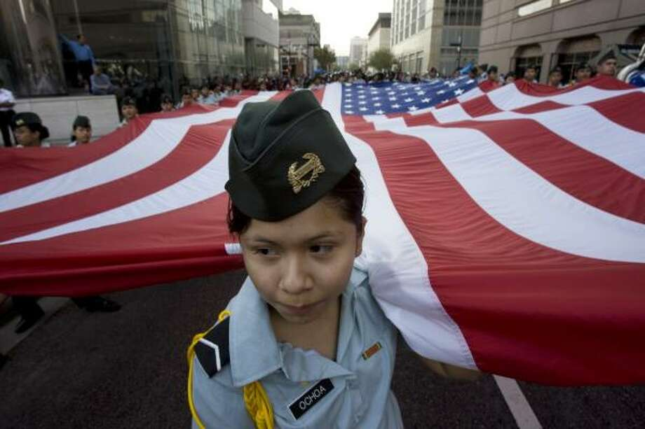 Cadet Pvt. Maria Ochoa, 14, from the Reagan High School JROTC program, said it was the first time she had participated in the parade. Photo: Johnny Hanson, AP