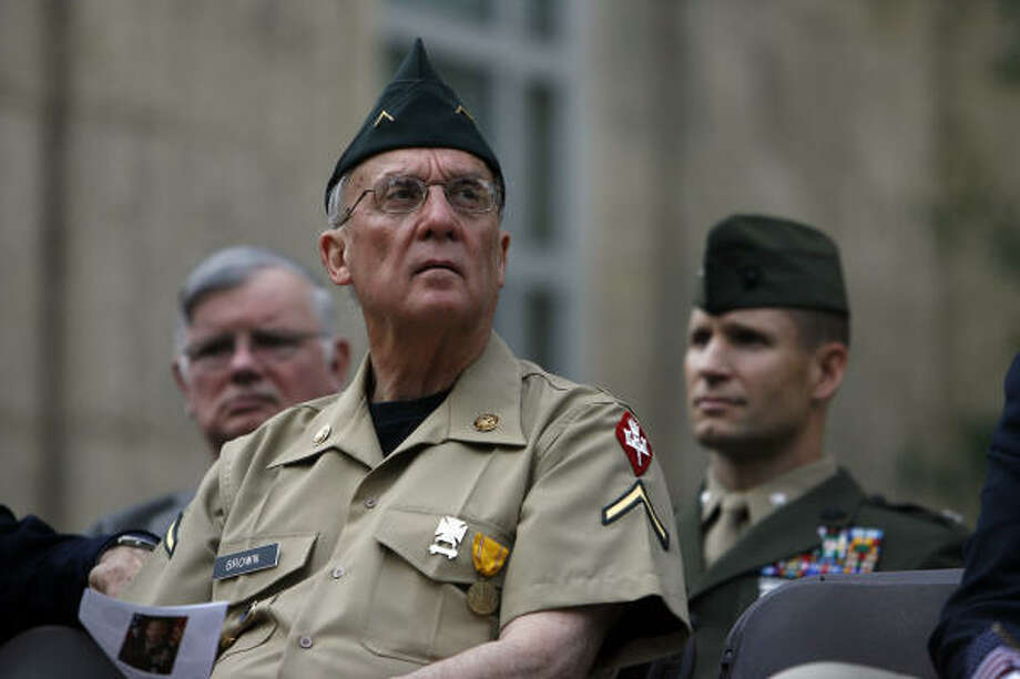 Houston City Council member and U.S. Army veteran Peter Brown listens to the Veterans Day ceremony in his military dress before the parade at City Hall Tuesday. Photo: Johnny Hanson, Chronicle