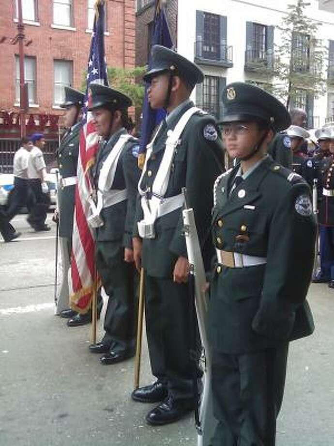 The Aldine ISD ROTC color guard lines up before the parade. Photo: Dean Betz, Chronicle