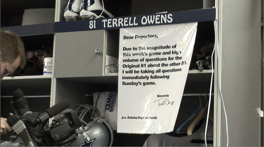 """In a statement to reporters that was taped to his  locker, Cowboys wide receiver Terrell Owens said he doesn't plan to answer questions about Sunday's showdown against unbeaten New England until after the game. In the note, Owens refers to himself as the """"Original 81"""" and to New England's Randy Moss as the """"other 81."""" Photo: Ron Baselice, AP"""