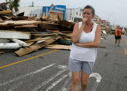 Diane Glowaeki walks among the debris on Seawall Bouevard in Galveston. Photo: Mark Wilson, Getty Images
