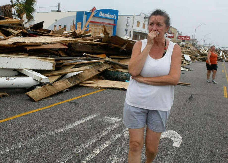 Diane Glowaeki walks among the debris on Seawall Bouevard in Galveston. Photo: Mark Wilson, Getty Images