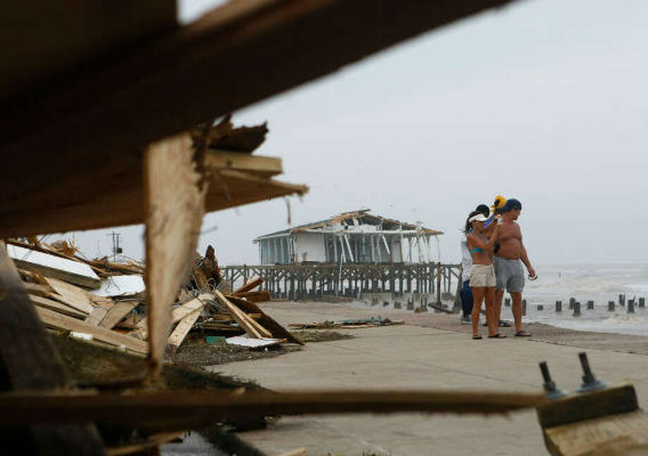 Galveston residents Shelly Stark and Wayne Huber look over the damage from Hurricane Ike. Photo: Mark Wilson, Getty Images