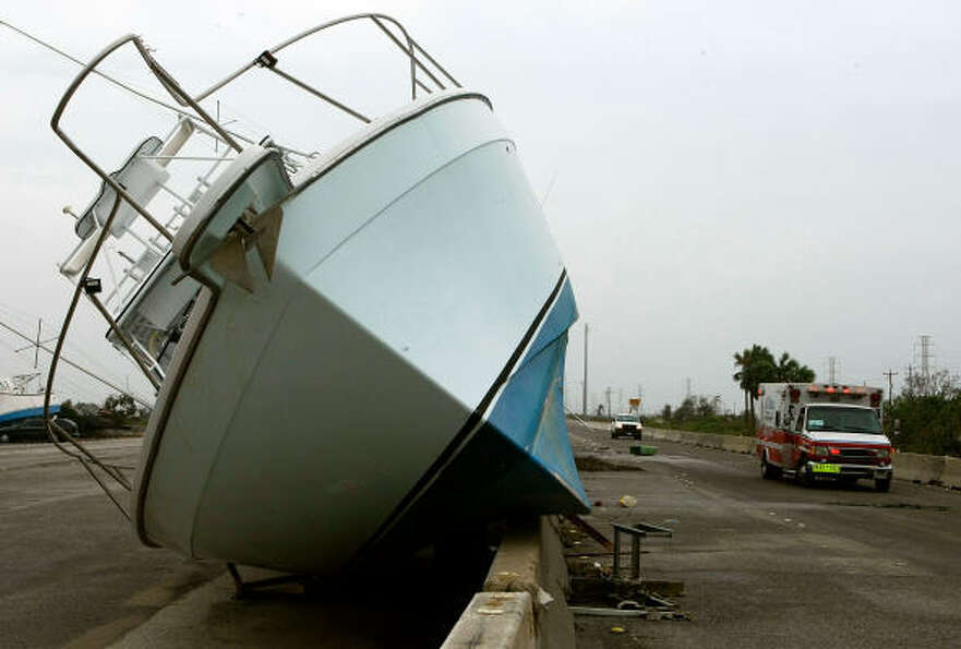 A boat sits on Interstate 45 after being flung from the bay by Hurricane Ike.