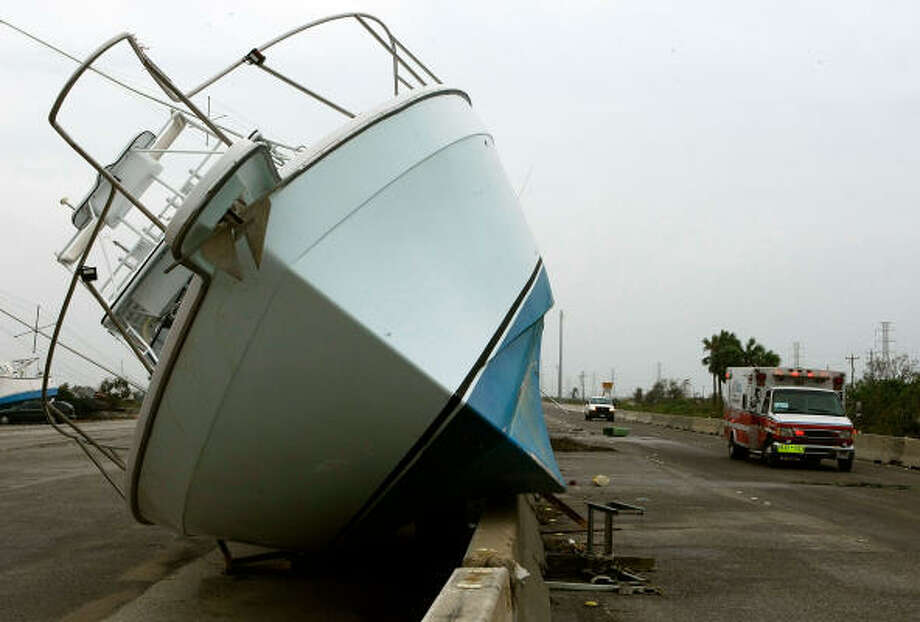 A boat sits on Interstate 45 after being flung from the bay by Hurricane Ike. Photo: Mark Wilson, Getty Images