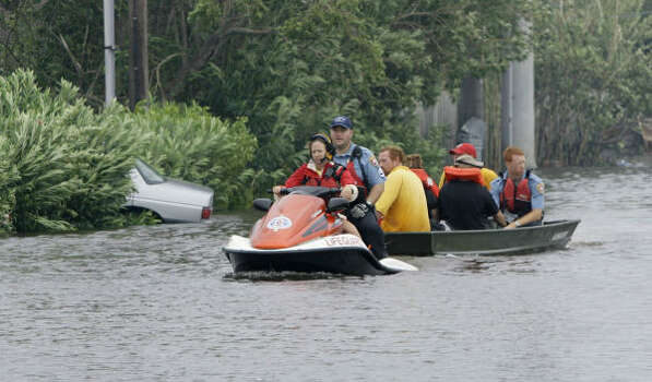 Rescue crews pull stranded Galveston residents from a flooded neighborhood. Photo: Matt Slocum, AP