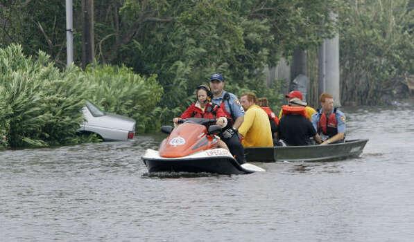 Rescue crews pull stranded Galveston residents from a flooded neighborhood. Photo: Matt Slocum, AP