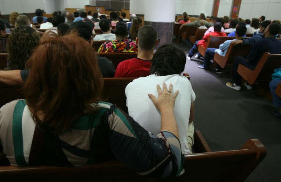 Parents and their children learn about the Harris County juvenile court system during a program that was started last month. Photo: Mayra Beltran, Chronicle