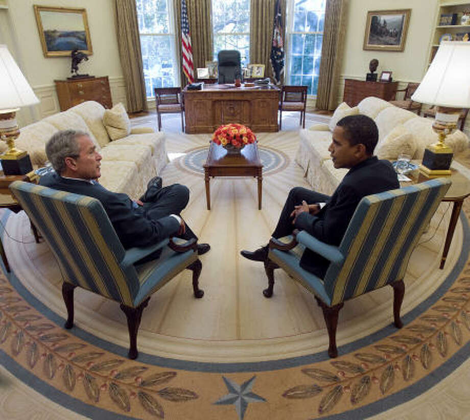 President-elect Barack Obama meets with President George W. Bush in the Oval Office of the White House in Washington, D.C., on Nov. 10. Bush invited Obama for the private talk, a rite of passage between presidents and successors that extends for decades. Photo: Eric Draper, The White House