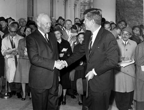 "President Eisenhower shakes hands with President-elect John F. Kennedy as he arrives at the White House on Dec. 6, 1960.  After the three-hour meeting, an aide later described Eisenhower as ""overwhelmed by Senator Kennedy, his understanding of the world problems, the depth of his questions, his grasp of the issues and the keenness of his mind."" Photo: AP"