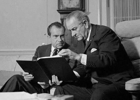 President Lyndon Johnson, right, confers with President-elect Richard Nixon in the White House on  Dec. 12, 1968. Photo: Charles Tasnadi, AP