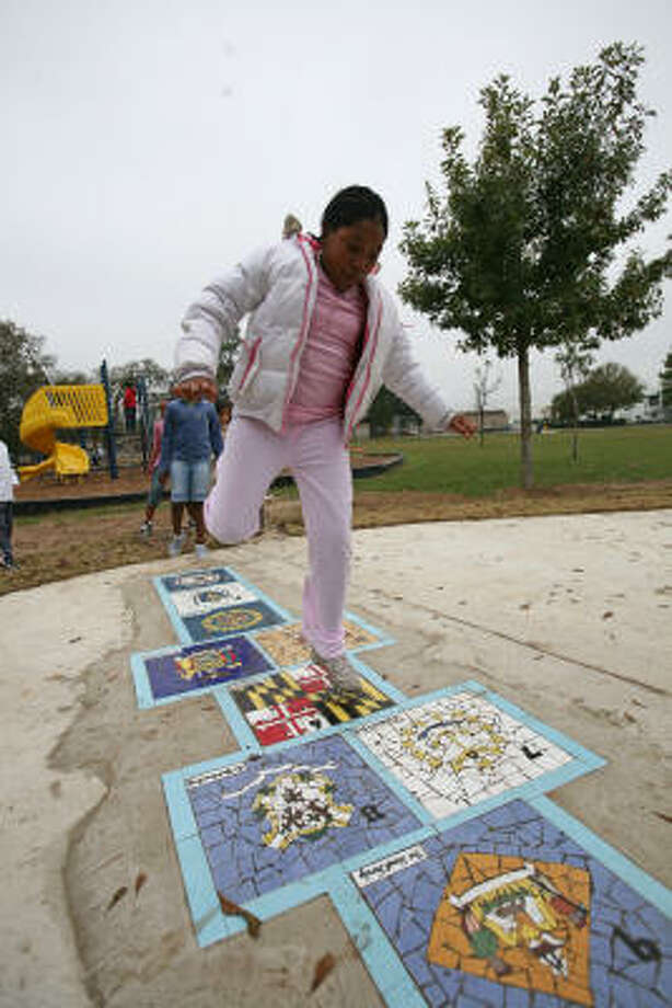 Hayle Thomas, 9, a third grader plays hopscotch in the new Meadow Wood Park. Photo: Suzanne Rehak, For The Chronicle