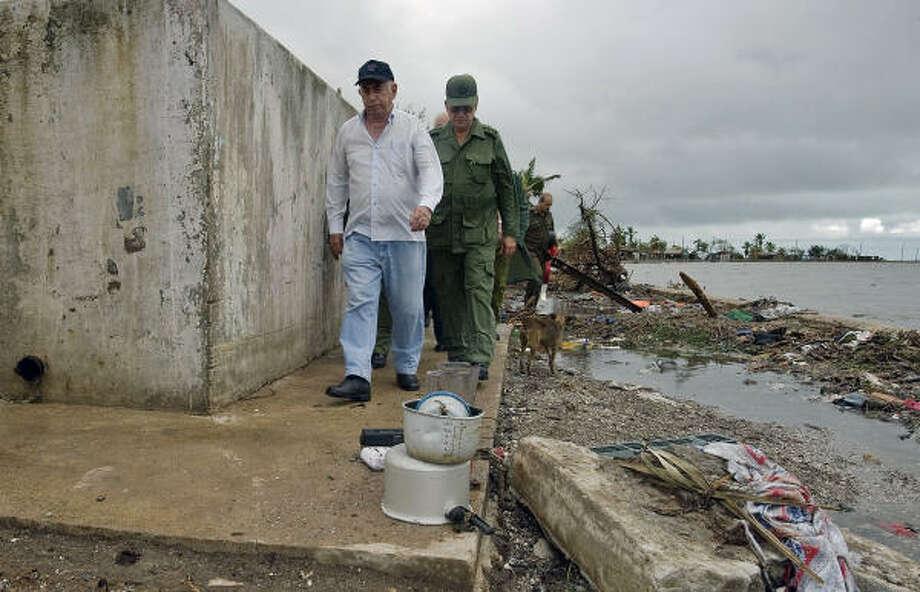 Cuban vicepresident Jose Ramon Machado Ventura, left, walks amidst the debris in Santa Cruz del Sur. Photo: ADALBERTO ROQUE, AFP/Getty Images