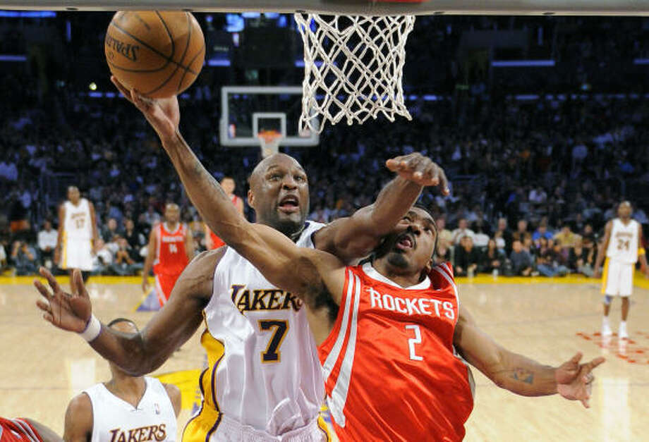 Lakers forward Lamar Odom makes life difficult for Luther Head in the second half. Miss any of the action? Get the statistics here. Photo: Mark J. Terrill, AP