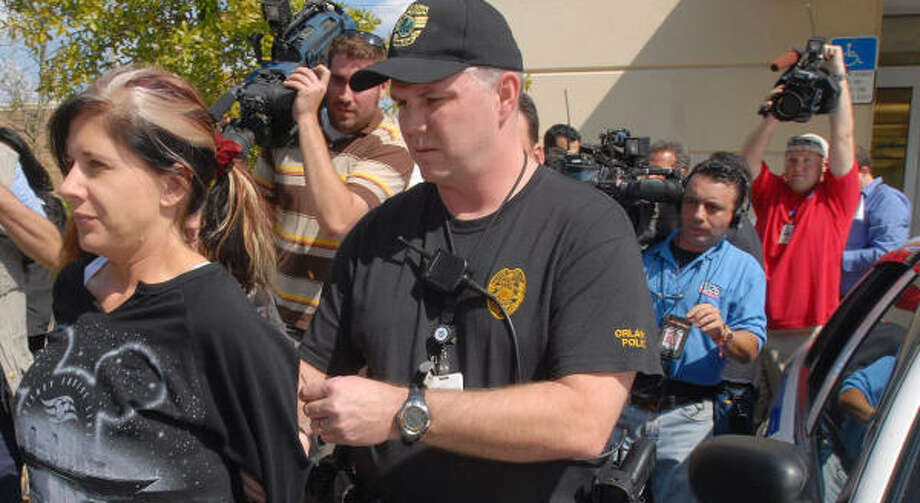 Naomi Loomis, owner of  Signature Compounding Pharmacy, is arrested in Orlando, Fla. Photo: Paul Buckowski, AP