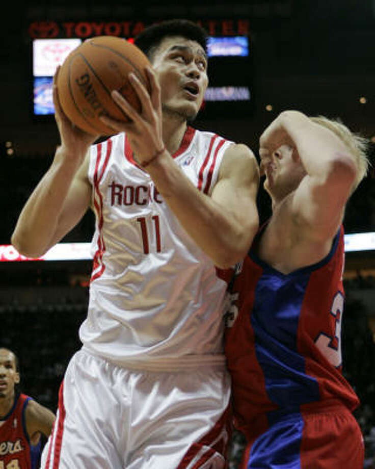 Yao Ming (11) hasn't played in a game since he went up against Chris Kaman and the Clippers on Dec. 23. Photo: David J. Phillip, AP