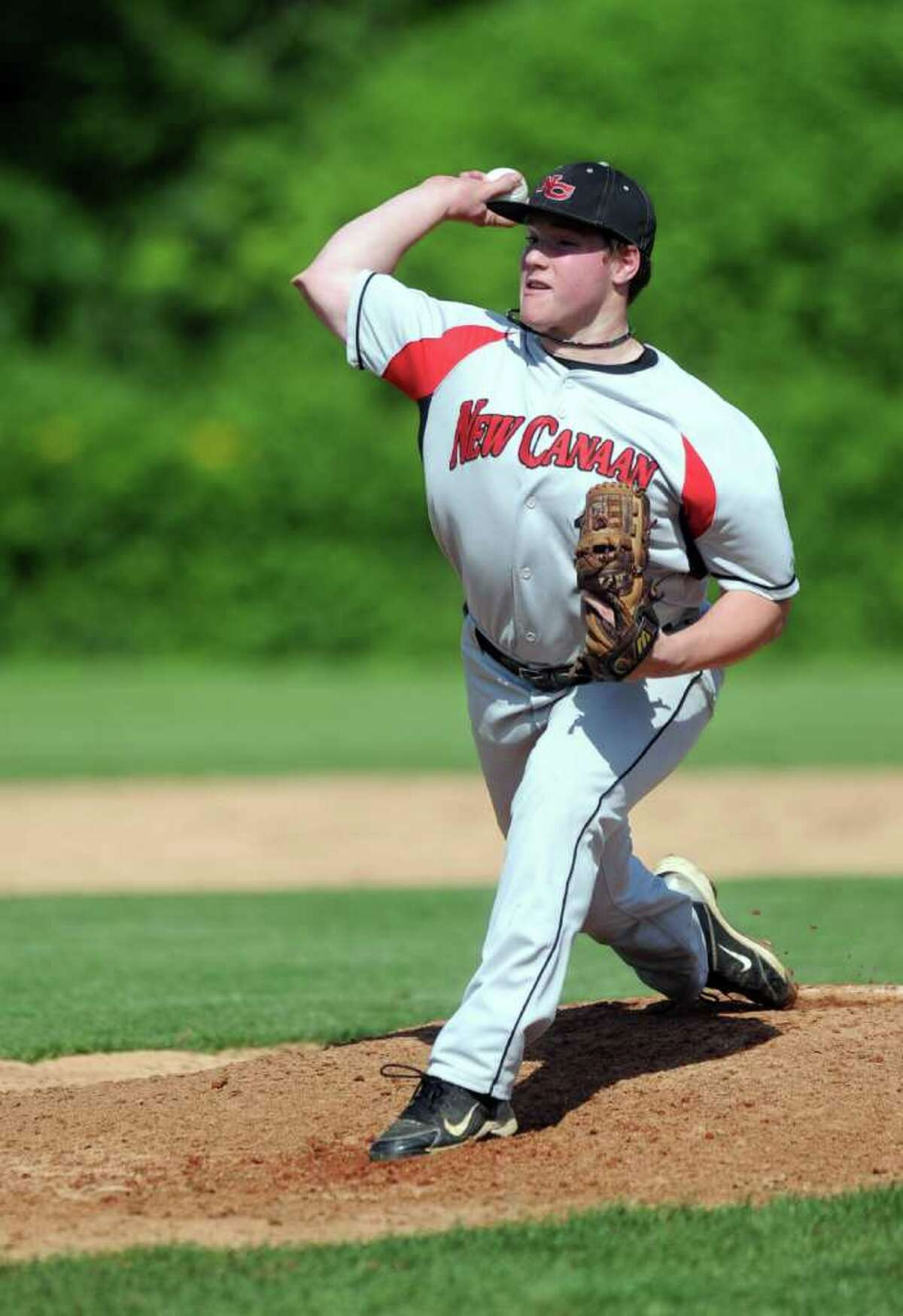 New Canaan's Alex Farina pitches during Wednesday's FCIAC quarterfinal game at Staples High School on May 25, 2011.