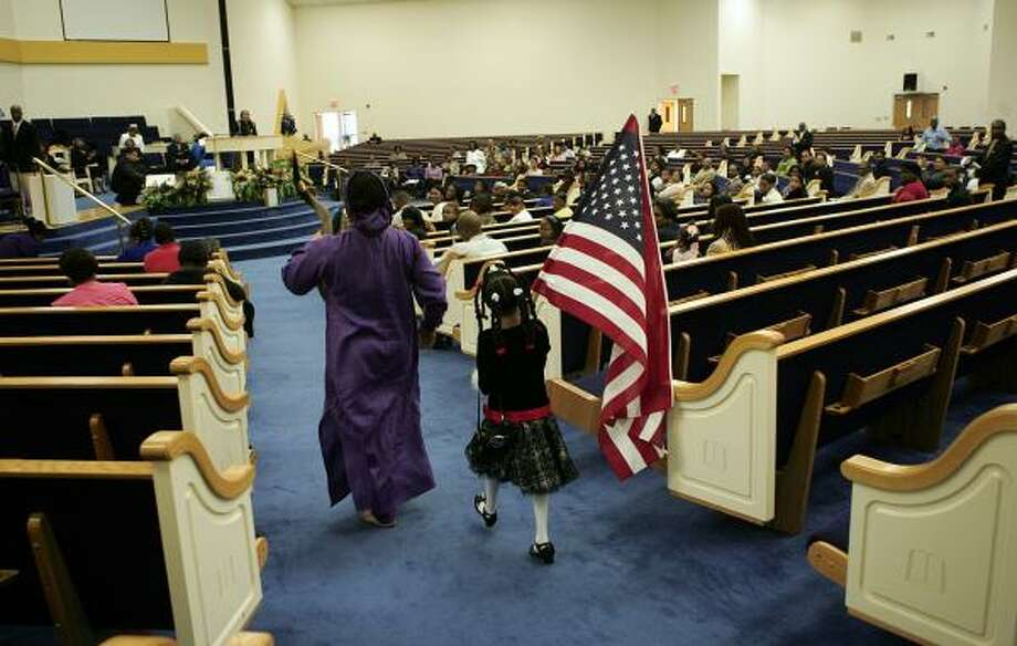 The American Flag is walked in to a church service at Mt. Calvary Word of God Church in Raleigh, N.C., Sunday. Photo: JIM BOUNDS, AP