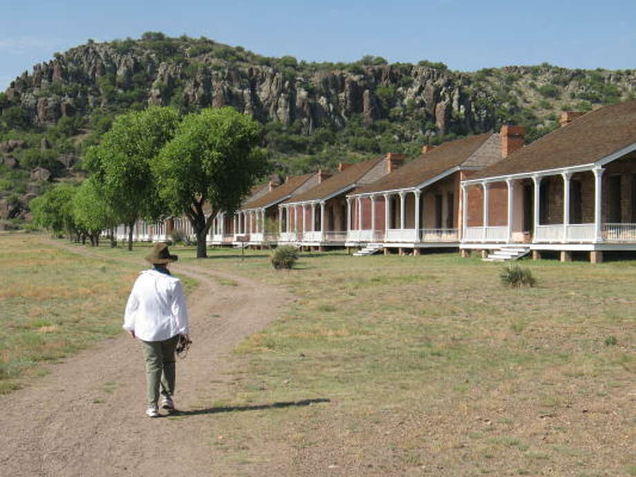 "Rugged terrain is a backdrop for the officer's quarters at Fort Davis National Historic Site, where many African-American ""Buffalo Soldiers"" served in the 19th century. Photo: Louis B. Parks, Chronicle File"